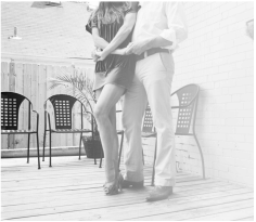 black and white photo of a man and a woman dancing intimately